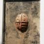 Wmurowana w zewnętrznej ścianie tarcza herbowa ze zniszczonego w latach 1659-1660 pomnika nagrobnego Piotra Wiesiołowskiego- młodszego, zmarłego w 1621r. Górne pola tarczy zajmują herby Wiesiołowskich-Ogończyk i Wołłowiczów-Bogoria. Pod nimi herby- Jastrzębiec i Korczak