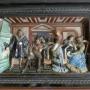 Figuralna scena w części centralnej kominka, przedstawiającą scenę zerwania Marcina Lutra z Rzymem