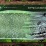 Tablica informacyjna w okolicy prehistorycznej kopalni krzemienia.